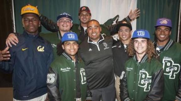Buena Park head coach Anthony White stands with players from last year's team who playing in college, including those at Cal, Utah and Univ. of New Mexico. Photo: hometeamsonline.com.